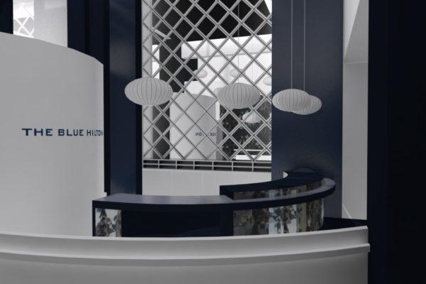 Réception Hilton aménagement et décoration miroir et bleu Alexandra Gilson